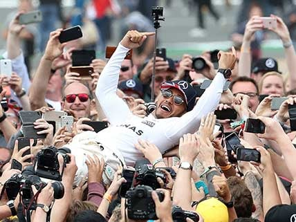 Hamilton revels in cutting Vettel's world championship lead after British GP win